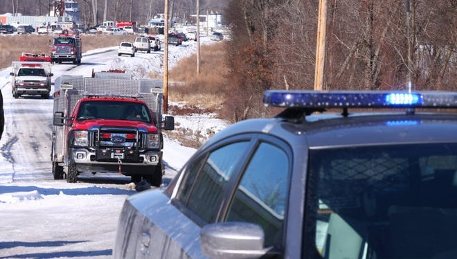 Emergency vehicles leave the scene of a boat explosion near Calvert City, Ky. Friday, Jan. 19, 2018. Work was being done on the vessel and dozens of people were either aboard the boat or at the site when the blast occurred shortly after 9 a.m. CST State Police Detective Jody Cash said.
