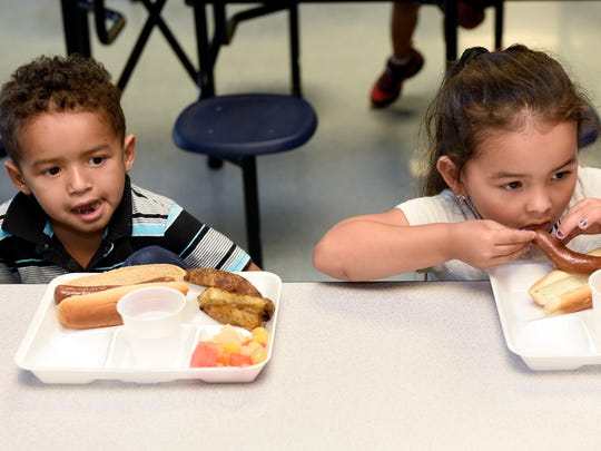 Christian Rene, left, and his cousin Emely Reivera enjoy their lunch on Monday, June 27, 2016 at BOPIC summer camp at Chamberburg Area Middle School South.