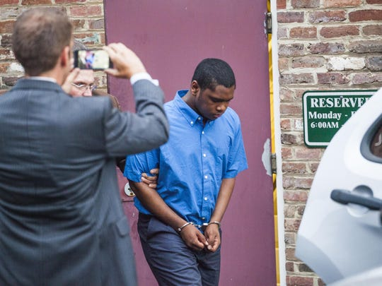 Isaiah Stuart, 17, is led out of the Cochran Judicial Center after being found guilty of second-degree murder in the slaying of Julian Parrott on Friday, Aug. 28, 2015.