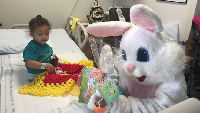 The Easter Bunny delivers an Easter bag to 2-year-old Anthonia Rodrigues Sousa.
