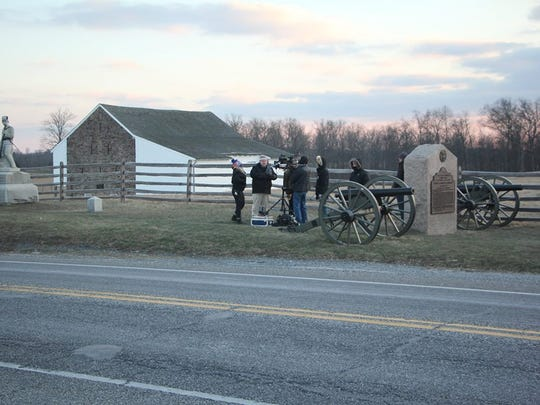 A film crew shoots footage near the McPherson Barn