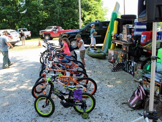 Kids check out some of the prizes available for the Cops and Bobbers fishing rodeo.