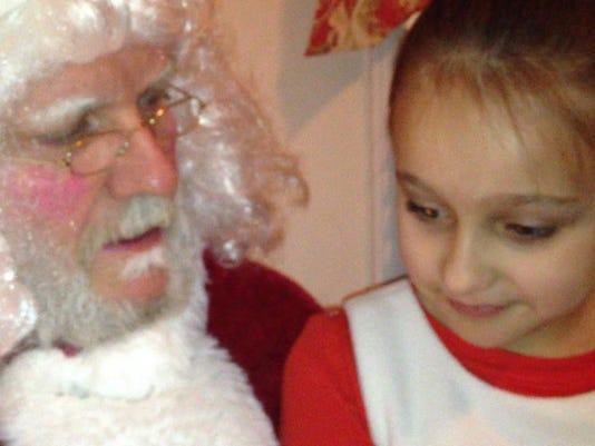 Tom Smith plays Santa