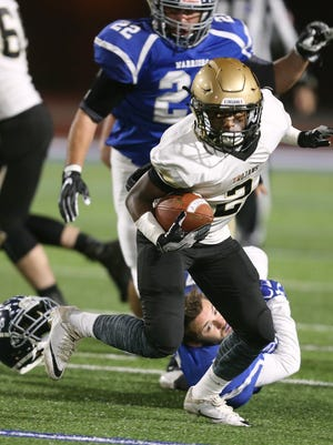 Athena's Thaj Avies slips a tackle as Whitesboro's Christian Baris loses his helmet in the Class A state semifinal game.
