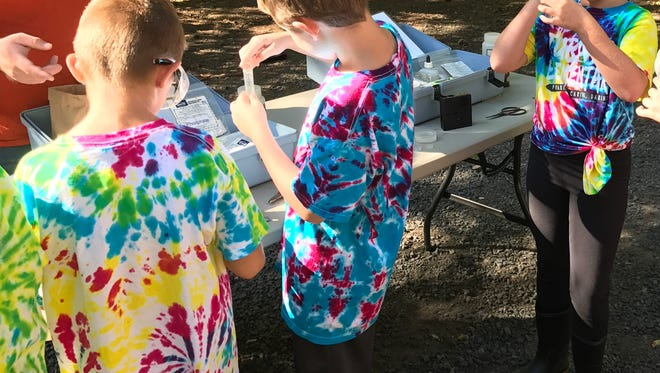Colorful day for Turner Elementary Students in the Cascade School District:4th grade students in tie-dye at Packsaddle Park studying the river and the spawning cycle of salmon on Thursday.