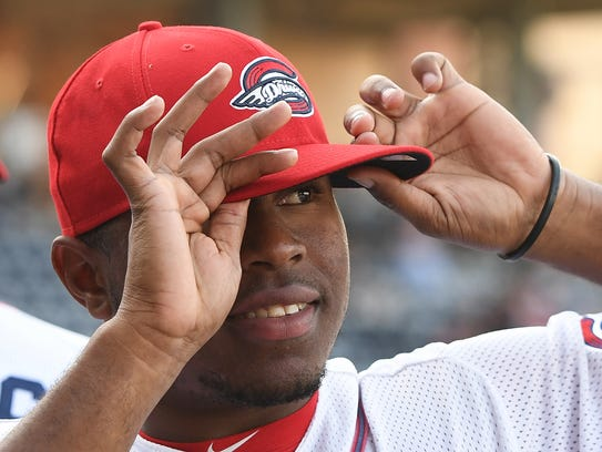 Greenville Drive pitcher Jun Florentino adjusts his