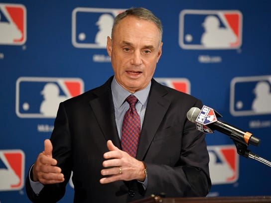 """FILE - In this Feb. 1, 2018 file photo Major League Baseball commissioner Rob Manfred speaks during a news conference at the baseball owners meetings in the Four Seasons Hotel in Los Angeles. Rebuilding _ or, to use the less euphemistic term, tanking _ has become one of baseball's most polarizing topics in 2018. Manfred has said """"our clubs, all of them, want to win. That's why the owners own, that's why the clubs play the game. The question is: What strategy are they going to adopt, over what period of time, to put themselves in a position to win?"""" (AP Photo/Mark J. Terrill)"""