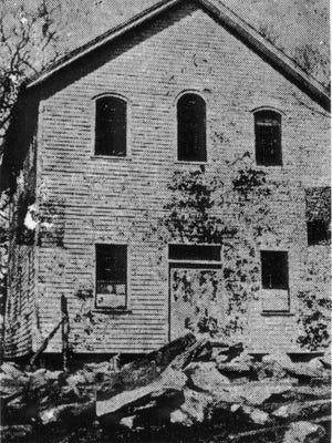 The Miller Meeting House, established in 1847, is shown here after James Buttrick of Epworth, England, added a second story. The Miller Meeting House was a forerunner of the Trinity United Methodist Church on Haywood Road.