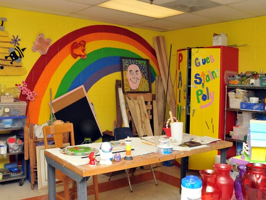 "Riverview Industries' ""Imagine Art"" studio is a bright,"