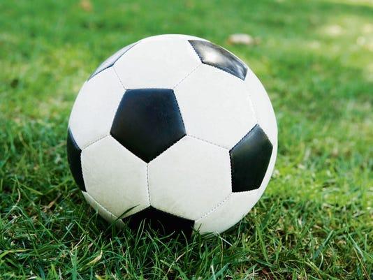 636131952714738185-soccerball-grass.jpg