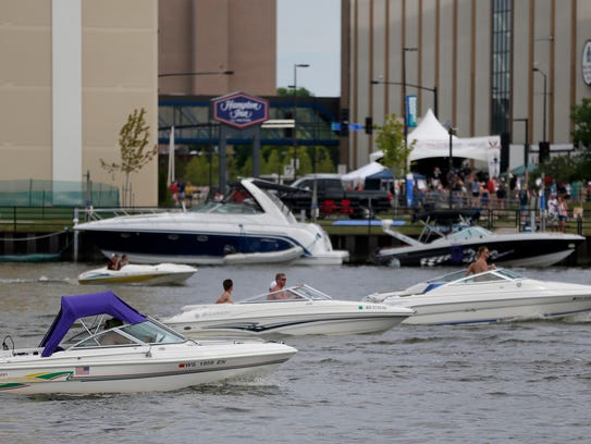 Many pleasure craft cruised the river near Leicht Park