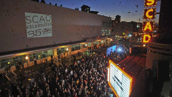 Confetti and thousands of paper airplanes fill the sky over Broughton Street at Savannah Film Festival kicked off at the SCAD Trustees Theater in 2013.