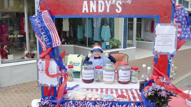 Andy Purcell tends to his politically-themed stand in downtown Richmond on Sunday.