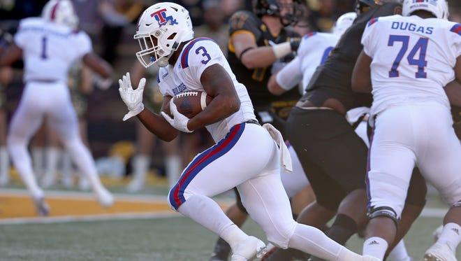 Louisiana Tech Bulldogs running back Jarred Craft (3) runs for a touchdown against the Southern Miss Golden Eagles in the first quarter at M.M. Roberts Stadium. Mandatory Credit: Chuck Cook-USA TODAY Sports