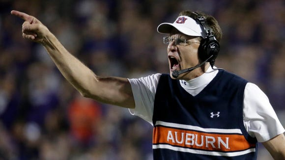 Auburn coach Gus Malzahn talks to an official during the game against Kansas State.