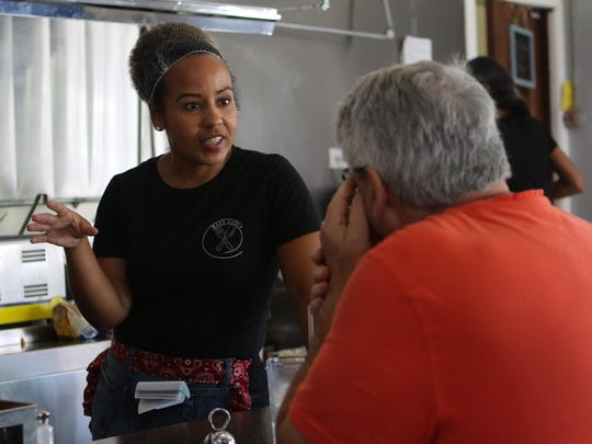 Stacey Stokes chats with a customer at Jerry Deen's Tuesday. Jerry Deen's opened on July 14 in the former Post House location.