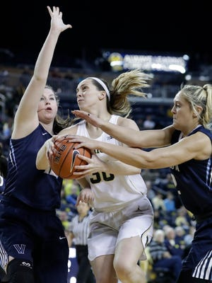Villanova's Alex Louin, right, reaches in on Michigan center Hallie Thome during the first half of U-M's 65-61 win in the WNIT semifinals Wednesday, March 29, 2017 at Crisler Center in Ann Arbor.