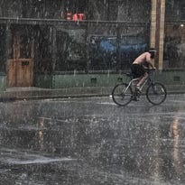 A cyclist races to beat severe storms in East Nashville earlier this spring.