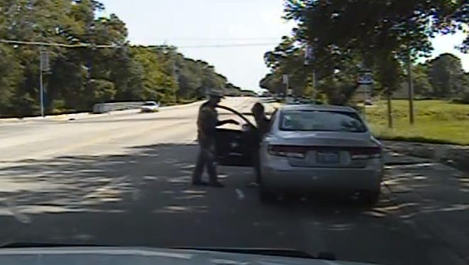 In this July 10, 2015, file frame from dashcam video provided by the Texas Department of Public Safety, Texas State Trooper Brian Encinia confronts Sandra Bland after a minor traffic infraction in Waller County,Texas.