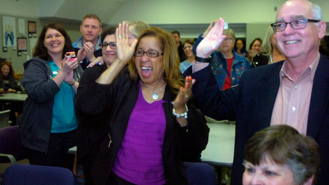 Farmington Board of Education President Sheliah Clay and Farmington Education Foundation member Tom Wilkinson cheer as election results are revealed.