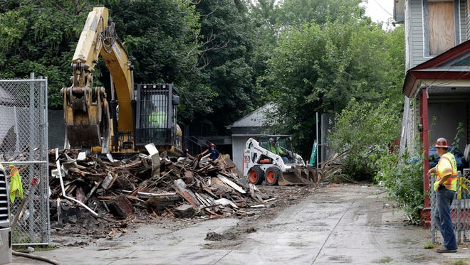 Workers demolish the house where three women were held captive and raped for more than a decade in Cleveland The owner, Ariel Castro, has been sentenced to life in prison for raping and kidnappng three young women and holding them captive in the house.