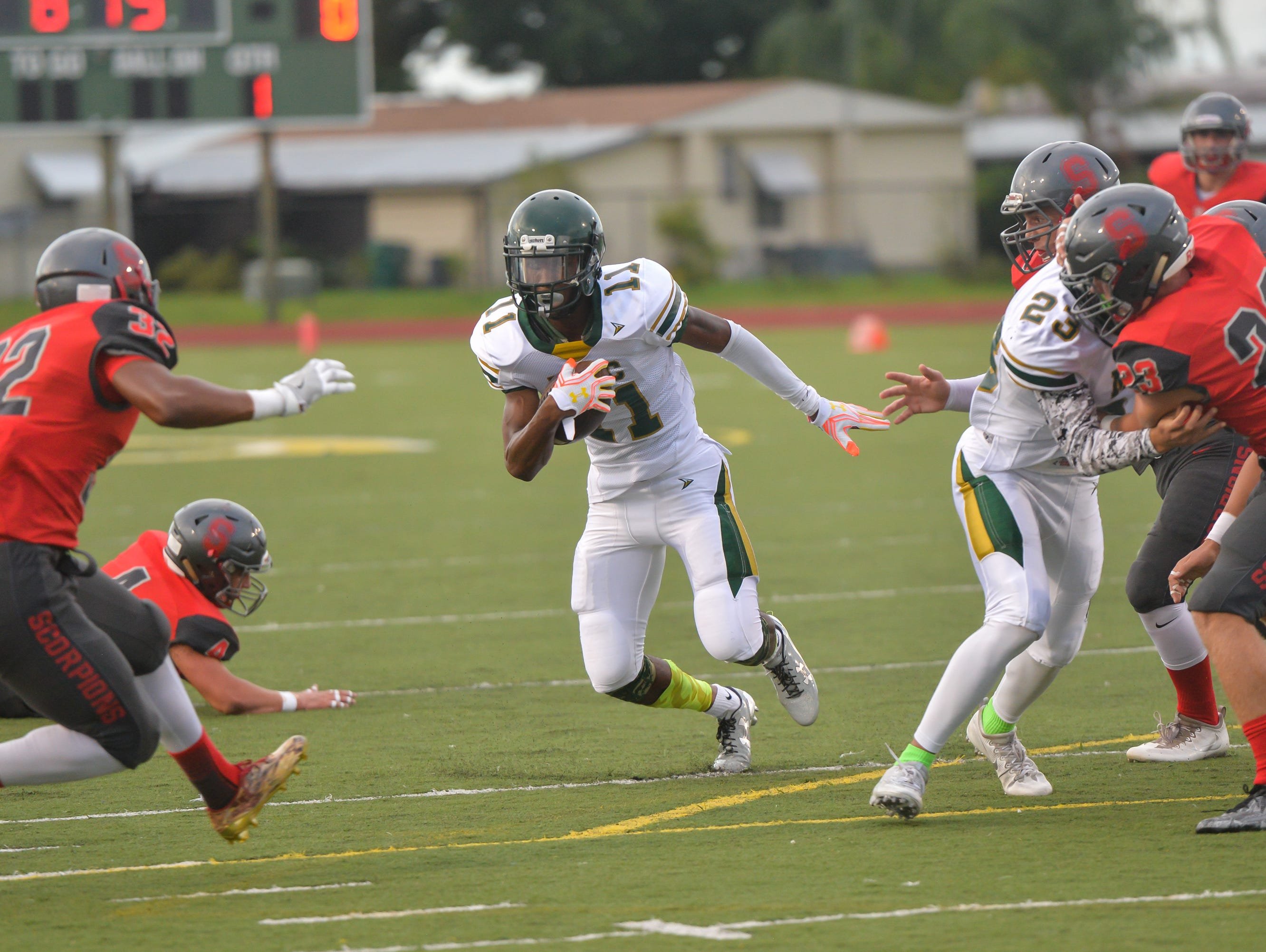MCC's Lorenzo Hardy runs through an opening during the first half against Satellite High at Melbourne Central Catholic High School.