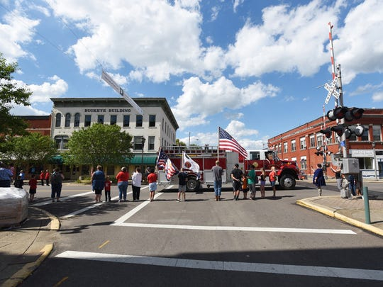 "A procession for Private Eugene J. ""Gene"" Appleby, who was killed during World War II, makes its way down Main Street in Coshocton on Tuesday. Appleby's remains were not found until 2011 and it  took several years to identify his remains. Funerals services will be on Thursday."
