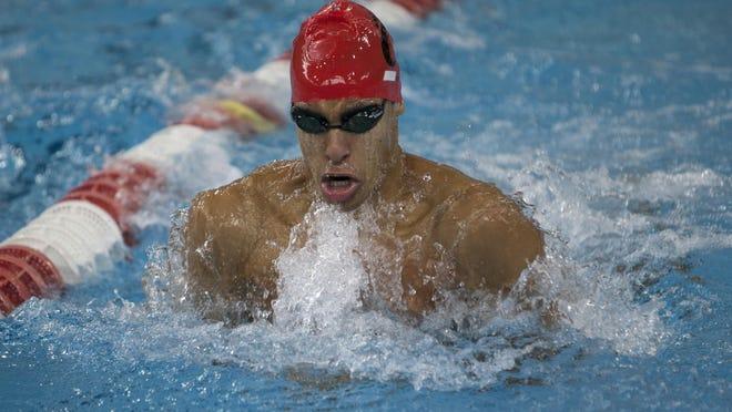 University of Cincinnati swimmer Ludo Corsini competes in the breaststroke at the Keating Aquatics Center.