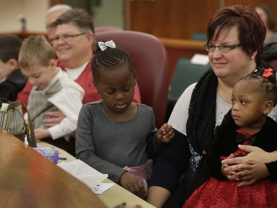 Hazel Park nurses Jayne Rowse, 50, left, and April DeBoer, 43, attend Michigan Adoption Day with their children Nolan DeBoer-Rowse, 5, left, Jacob DeBoer-Rowse, 5, Ryanne, DeBoer-Rowse to finalize their fourth adoption of 28-month old Rylee DeBoer-Rowse (red dress) Tuesday Nov. 25, 2014 at the Oakland County Court House in Pontiac. April DeBoer and her partner Jayne Rowse are plaintiffs battling for marriage equality in Michigan. They have petitioned the U.S. Supreme Court to hear their case. Mandi Wright/Detroit Free Press