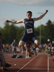 Bay Port's Zach Lorbeck flies while competing in the Division 1 long jump during the WIAA state track and field meet.