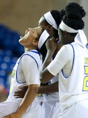 Delaware's Erika Brown reacts after she was fouled while making a basket with .4 seconds remaining in the third quarter of a win over William & Mary last year.