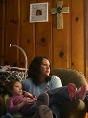 Four-year-old Kaylyn sits with her mother Terra Fortner as she speaks with The Jackson Sun at their home in Trenton, Tenn., on Friday, Dec. 9, 2016.