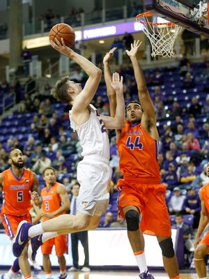 Evansville forward David Howard (44) tries to block a shot by Northern Iowa's Bennett Koch during game action at the McLeod Center in Cedar Falls, Iowa, Wednesday, Jan. 25, 2017.