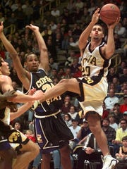 -Iowa's Dean Oliver, right, drives to the basket in front of Coppin State's Jerel Seamon (24) during the first half, Wednesday, Dec. 23, 1998, in Iowa City, Iowa.