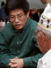 Zehao Zhou of York talks with Anthony Danna, an Air
