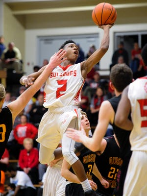 Bosse's Mekhi Lairy (2) shoots past Gibson Southern's Mason Bittner (33) and Gibson Southern's Andrew Smith (3) during the Class 3A Boonville sectional quarterfinals at Boonville High School, Tuesday, Feb. 28, 2017. Bosse beat Gibson Southern 78-54.
