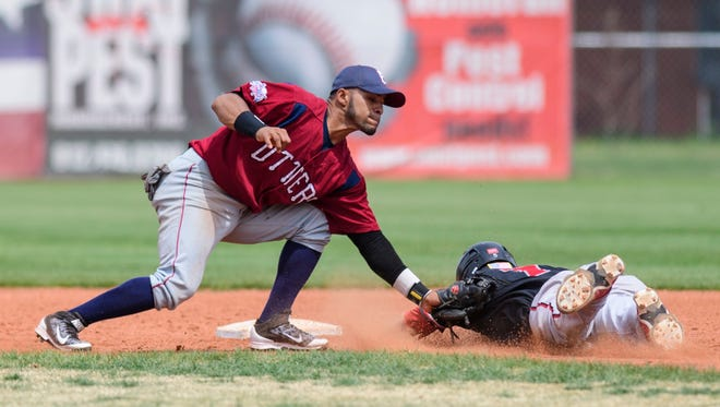 Evansville's Pedro Barrios tags Florence's Cutter McDowell on second base during the ninth inning of an Education Day exhibition game at Bosse Field in Evansville, Ind., Wednesday, May 2, 2018. The Freedoms defeated the Otters 10-8 after playing 11 innings.