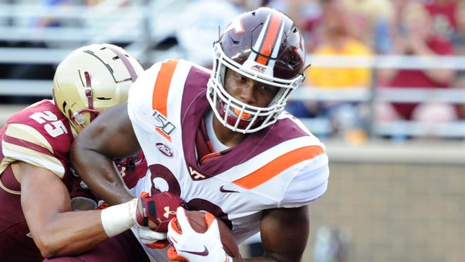 Aug 31, 2019; Chestnut Hill, MA, USA; Virginia Tech Hokies tight end James Mitchell (82) makes a touchdown catch past Boston College Eagles defensive back Mehdi El Attrach (25) during the second half at Alumni Stadium. Mandatory Credit: Bob DeChiara-USA TODAY Sports