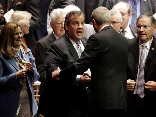 Former New Jersey Gov. Chris Christie, center left,