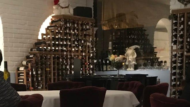 A quiet corner with the wine rack at Bistro la Baguette