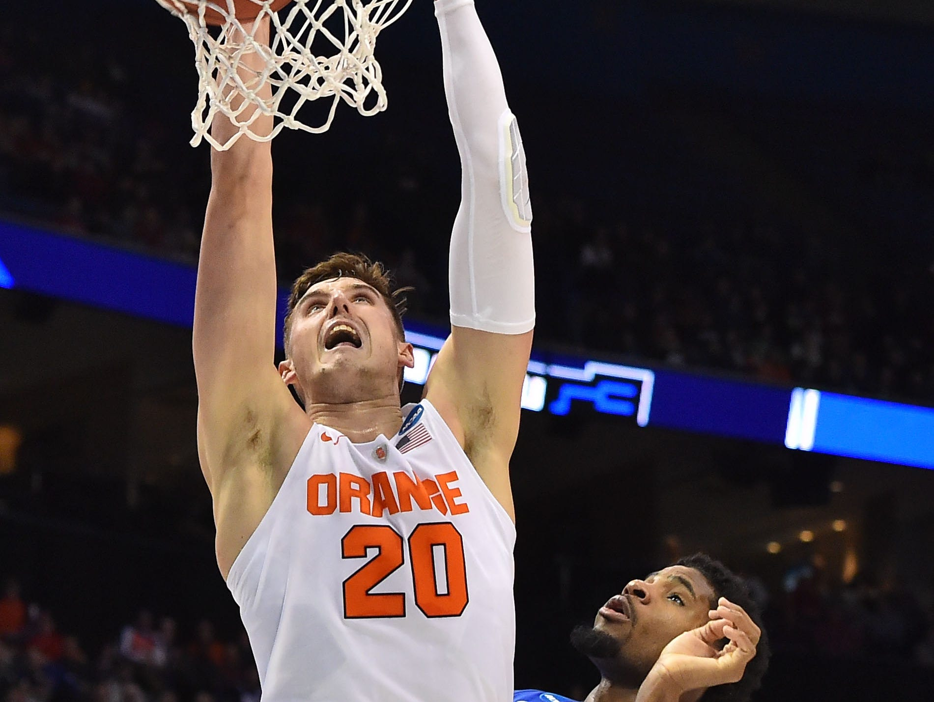 Syracuse's Tyler Lydon dunks while Middle Tennessee's Perrin Buford looks on at Scottrade Center in St. Louis, Missouri Sunday.