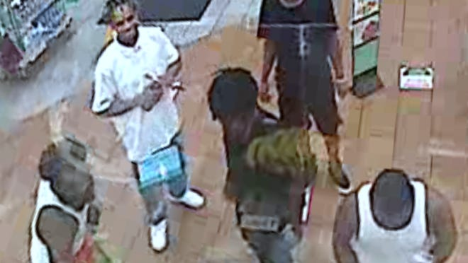 Police are searching for five men they say robbed and beat up a person last month in Northeast Austin.