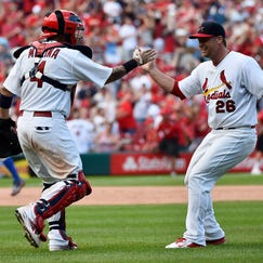 Aug 31, 2014; St. Louis, MO, USA; St. Louis Cardinals catcher Yadier Molina (4) celebrates with St. Louis Cardinals relief pitcher Trevor Rosenthal (26) after defeating the Chicago Cubs 9-6 at Busch Stadium. Mandatory Credit: Jasen Vinlove-USA TODAY Sports
