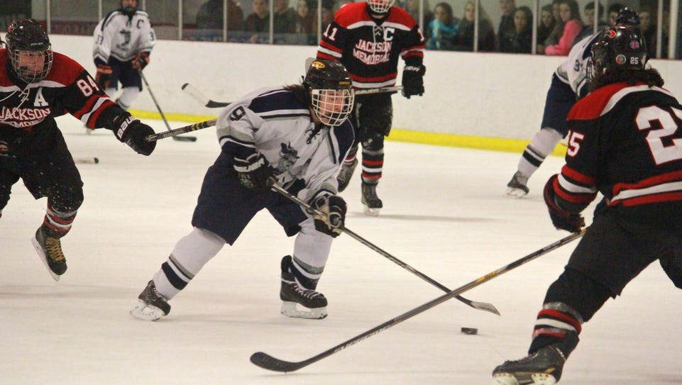 Howell's hockey team is seen playing Jackson Memorial