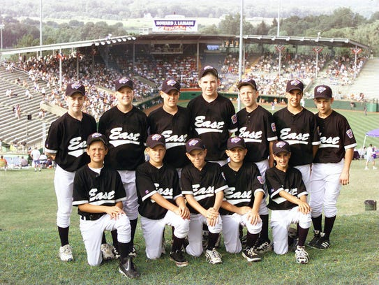 The Toms River East American Little League team gathers