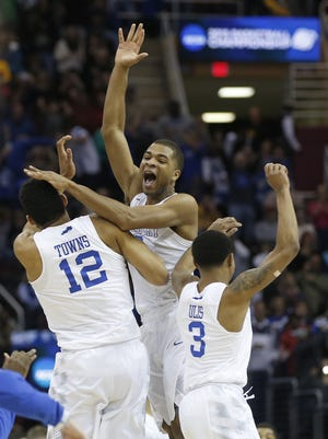 The Kentucky Wildcats celebrate their 68-66 win during the NCAA Tournament college basketball Round of 8 game against Notre Dame, Saturday, March 28, 2015, at Quicken Loans Arena in Cleveland.