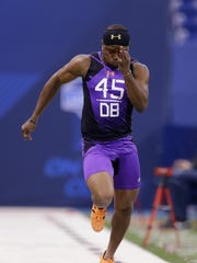 Here, D'Joun Smith runs the 40-yard dash at the NFL football scouting combine in Indianapolis in February. On draft night, he said he was only thrown at 11 times as a senior.