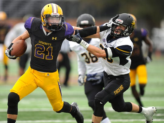 Hardin-Simmons wide receiver Reese Childress (21) shoves