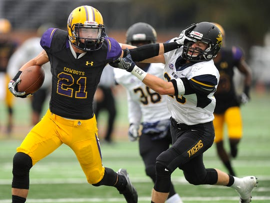 Hardin-Simmons wide receiver Reese Childress (21) shoves away East Texas Baptist safety Zackary Biles (28) during the second quarter of the Cowboys' 66-30 win on Saturday, Nov. 5, 2016, at HSU's Shelton Stadium.