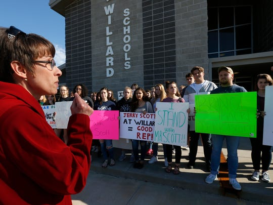 Vicky Scott, the wife of former Willard choir teacher Jerry Scott who was removed from his job last week, speaks to students who were protesting his removal outside of the Willard Public Schools administration building on Tuesday, April 10, 2018.